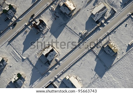 aerial view over private houses in wintertime - stock photo