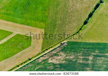aerial view over rural field - stock photo