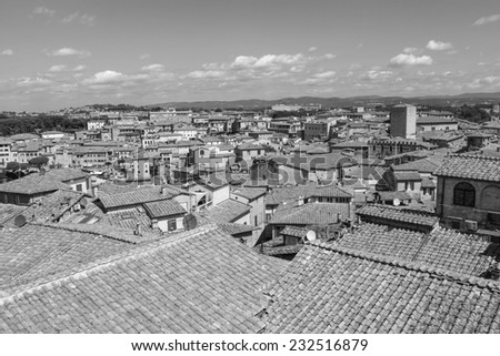 Aerial view over Siena (city in Tuscany) in Italy, Europe (black and white) - stock photo