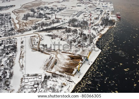 Aerial view over small harbor - stock photo