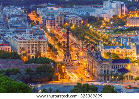 Aerial view over square Portal de la pau, and Port Vell marina and Columbus Monument at night in Barcelona, Catalonia, Spain - stock photo
