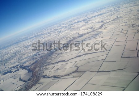 aerial view over the agricultural plant,winter season - stock photo