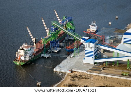 Aerial view over the fertilizer loading terminal and cargo ship - stock photo