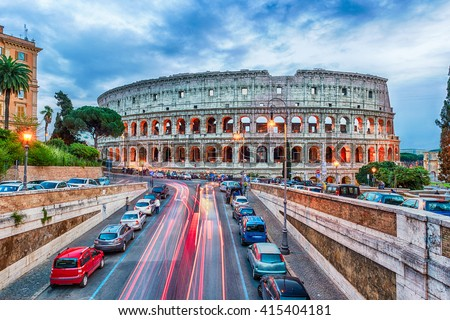 Aerial view over the Flavian Amphitheatre, aka Colosseum in Rome, Italy. Long exposure at dusk - stock photo