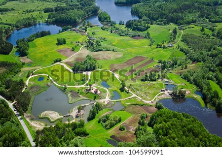 aerial view over the many small lakes and church - stock photo