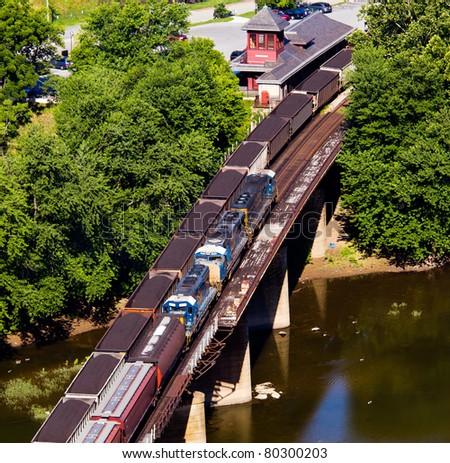 Aerial view over the National Park town of Harpers Ferry in West Virginia with railway station and freight trains - stock photo