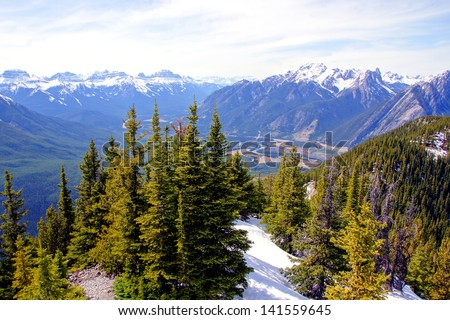 Aerial view over the peaks and forests of the Rocky Mountains at Banff, Canada - stock photo