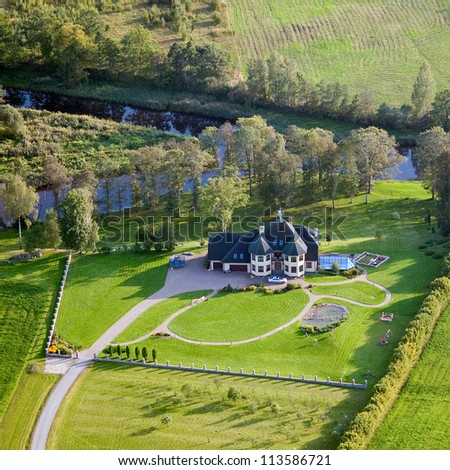 aerial view over the private cottage - stock photo