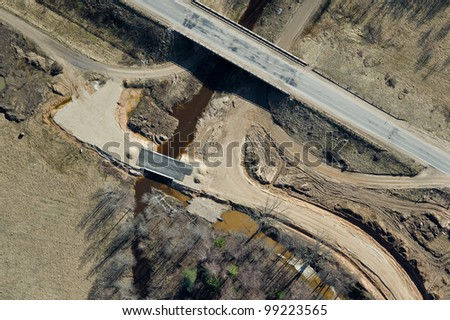 aerial view over the road and bridge under construction - stock photo