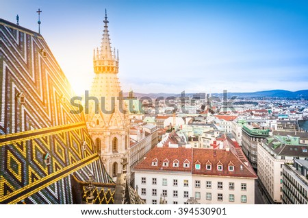 Aerial view over the rooftops of Vienna from the north tower of St. Stephen's Cathedral including the cathedral's famous ornately patterned, multi colored roof created by 230,000 glazed tiles, Austria - stock photo