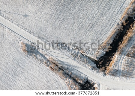 aerial view over the rural field and country road