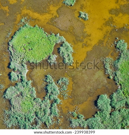 aerial view over the shallow lake - stock photo