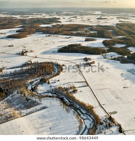 aerial view over the snowy fields