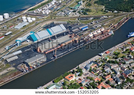 aerial view over the Ventspils free port - stock photo