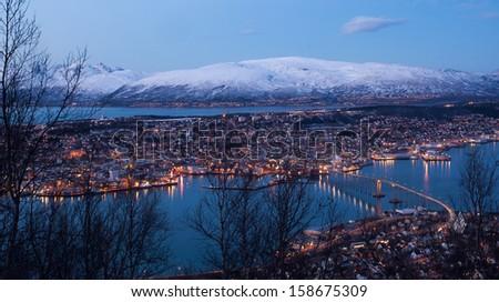 Aerial view over Tromso Bridge - linking the mainland  - stock photo