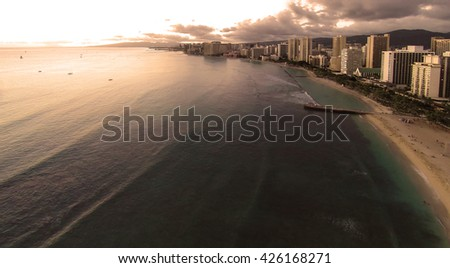 Aerial view over Waikiki at sunset golden hour - stock photo