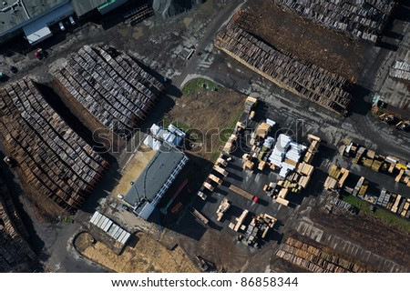 aerial view over wood processing factory - stock photo