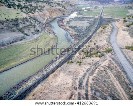 aerial view railroad, highway and  of the Colorado RIver above Dotsero, Colorado, springtime scenery - stock photo