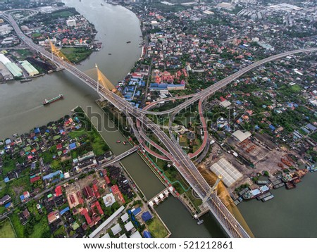 Aerial view Road roundabout with car lots in Thailand. Bhumibol Bridge in Thailand. street large beautiful downtown at night.cityscape.