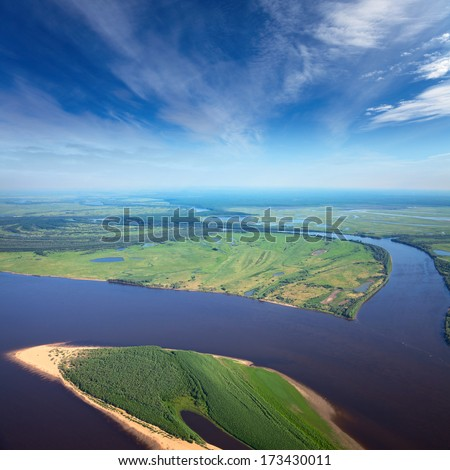 Aerial view the great river during summer day on background of white clouds.