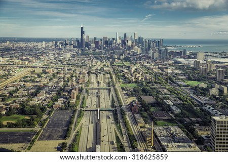 Aerial view through Chicago Downtown with highway and railroad - stock photo