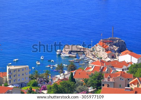 Aerial view to an old harbor with traditional stone buildings near the Adriatic sea, Montenegro - stock photo