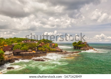 Aerial view to balinese Tanah Lot sea temple, famous touristic landmark to visit at Bali, Indonesia - stock photo