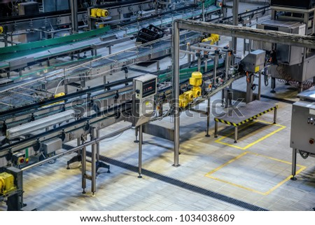 Aerial view to conveyor belts of production line.