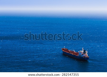 Aerial view to empty container cargo ship in the blue ocean - stock photo