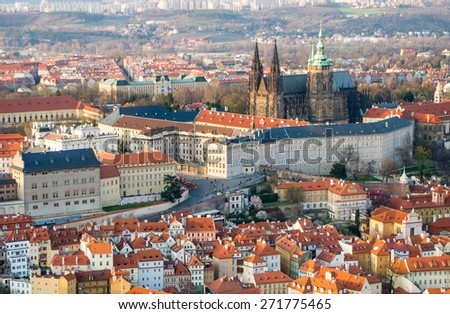 Aerial view to famous Prague castle (Prazsky hrad) -Czech president residence, and St. Vitus Cathedral in sunset lightning, UNESCO world heritage site- view from Petrin tower in Prague, Czech republic - stock photo