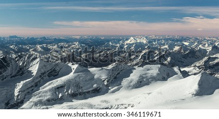 aerial view to many snowy mountain tops in tyrol austria - stock photo