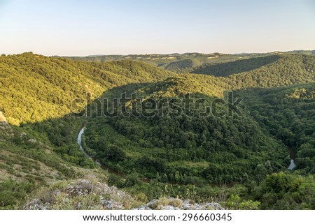 Aerial view to river bend in the mountain - stock photo