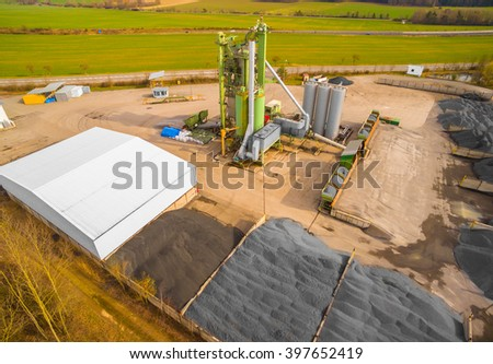 Aerial view to tarmacadam plant near new highway construction. Industrial landscape in Czech Republic, Europe. - stock photo