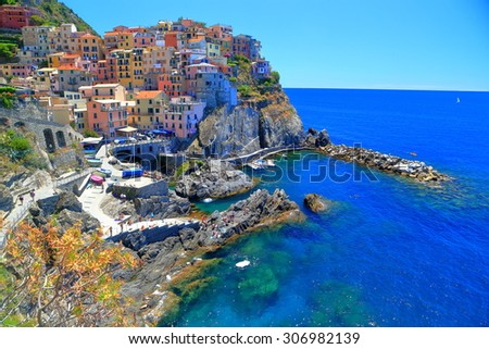 Aerial view to the harbor and old town of Manarola, Cinque Terre, Italy - stock photo