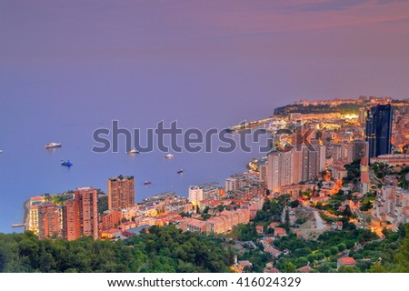 Aerial view to the harbor and town of Monte Carlo at evening, Monaco, French Riviera - stock photo