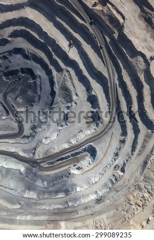 Aerial view to the iron ore open mine - stock photo