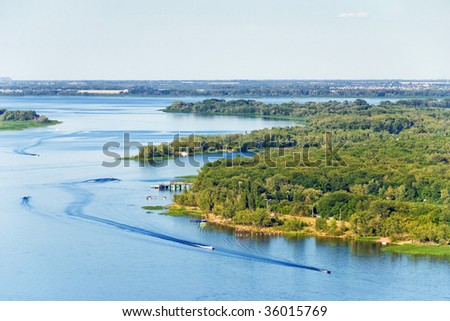 Aerial view to the River with Motorboats - stock photo