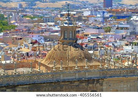 Aerial view to the rooftop above the Cathedral of Saint Mary of the See (Seville Cathedral), Seville, Andalusia, Spain - stock photo
