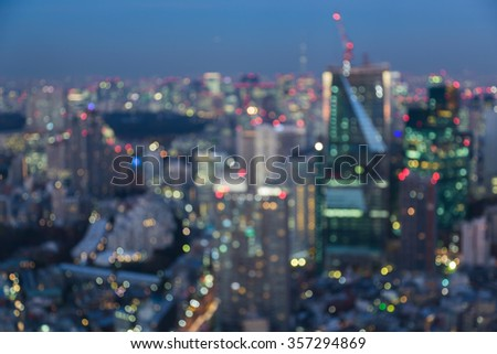 Aerial view Tokyo city light blurred bokeh background night view - stock photo