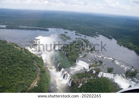 Aerial view toward Iguazu Falls' Devil's Throat Waterfall - stock photo