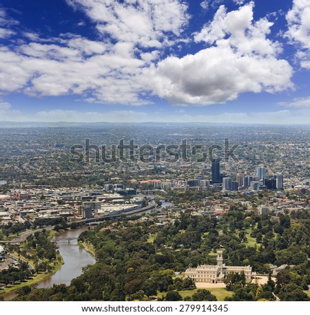 Aerial view towards Melbourne's North from the top of Eureca. Underlying park, Yarra river, palace and residential suburbs with skyscrapers - stock photo