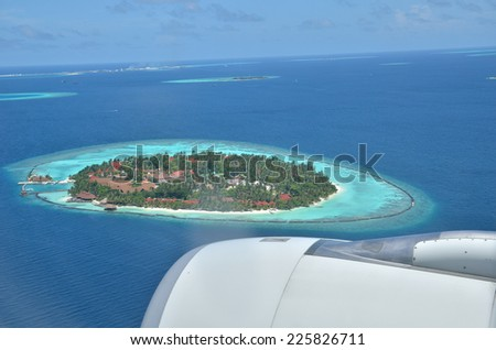 Aerial view tropical island resorts of maldives - stock photo
