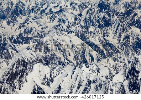 Aerial views in Tibet fly over to mountain Himalaya . View from the plane window - stock photo