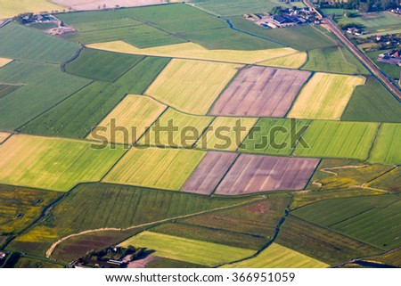 Aerial vista of farm lands at Amsterdam Schiphol Airport - stock photo