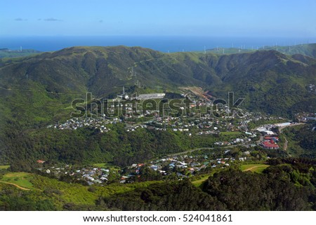Aerial Wellington view of Crofton Downs and  Wadestown suburbs with the Makara Wind Farm in the Background.