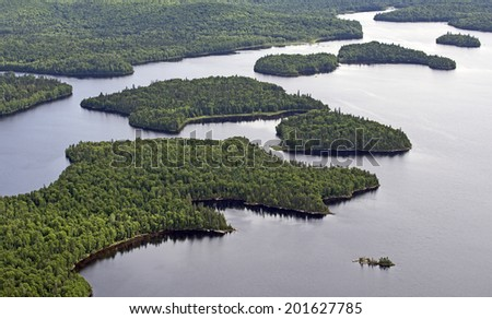 aerial wild forest and lake in northern quebec canada - stock photo