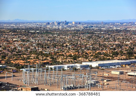 Aerial Zoom view from helicopter of downtown and the skyline of Phoenix, Arizona - stock photo