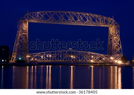 aeriel lift bridge in Duluth on Lake superior at dusk - stock photo