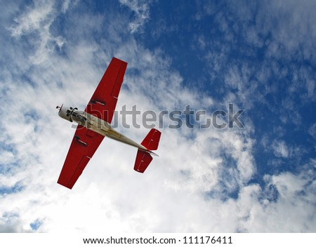 Aerobatic airplane in the sky - stock photo