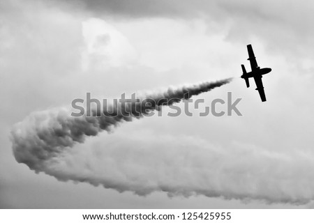 Aerobatic flying team jet aircraft in monochrome - stock photo
